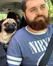 Matt Parker in a car with his dog