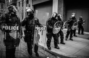 Police in riot gear lined up